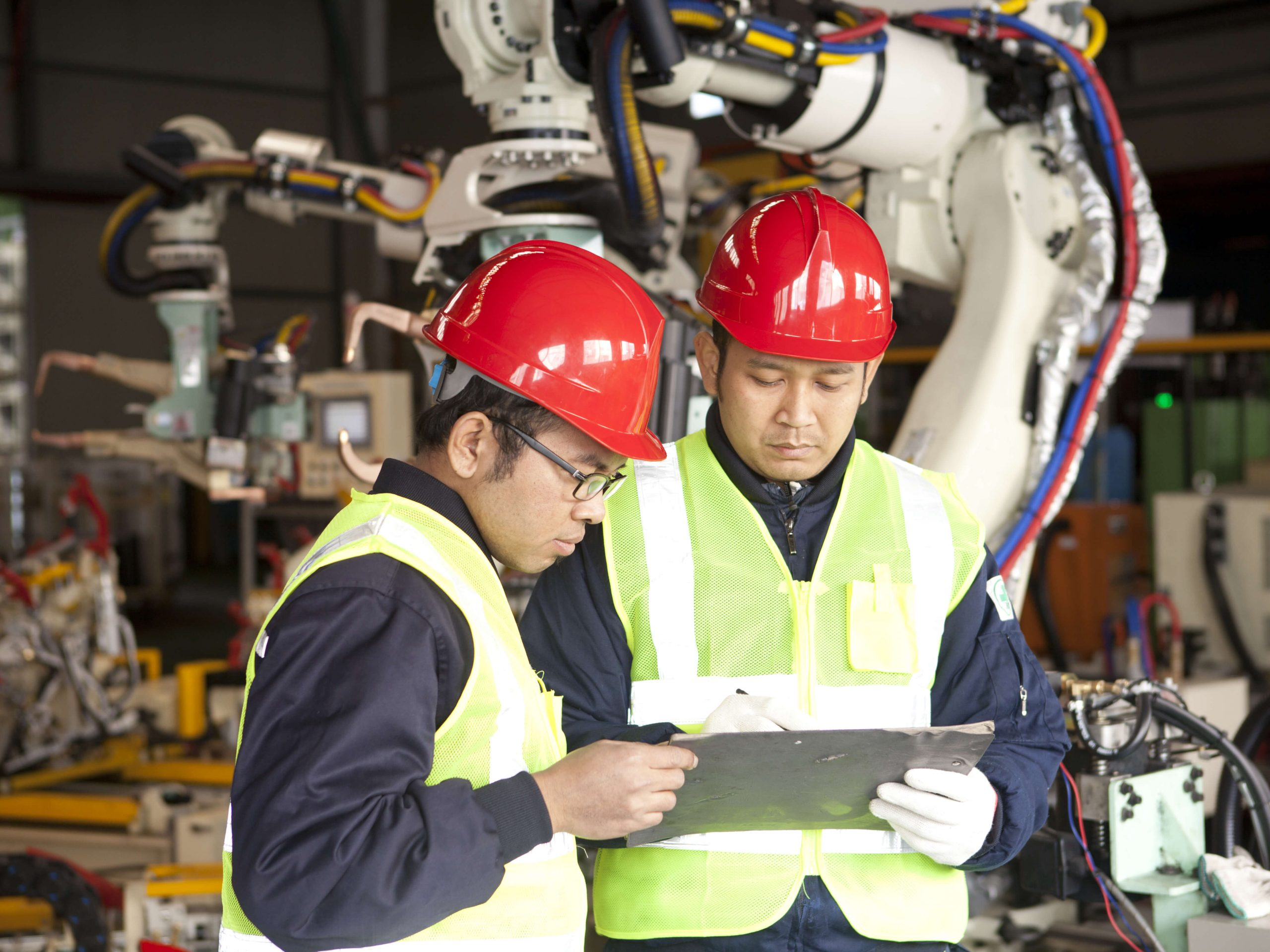 workers recording a 5S audit